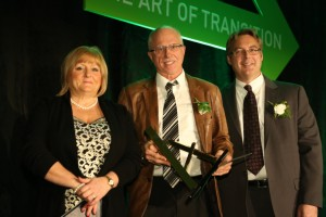 Henry Kortekaas (Middle) pictured with the Durham Region Art in Transition Creative Art Award.